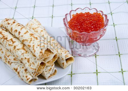 Pancakes With Red Caviar On A Plate