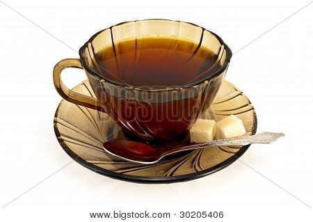 Tea In A Cup With A Spoon Of Brown Sugar And