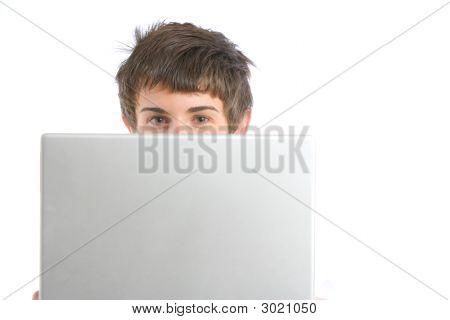 A Business Man Peeking Over A Modern Laptop
