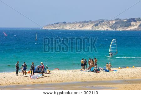 People On Busy Active Kitesurfing Beach In Spain