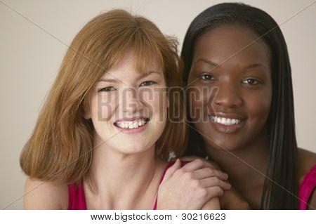 Two teenaged girls smiling