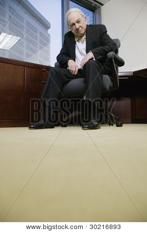 Senior businessman with pensive expression