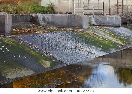 old diversion dam with irrigation ditch inlet - Cache la Poudre River in Fort Collins, Colorado, fall scenery with low water