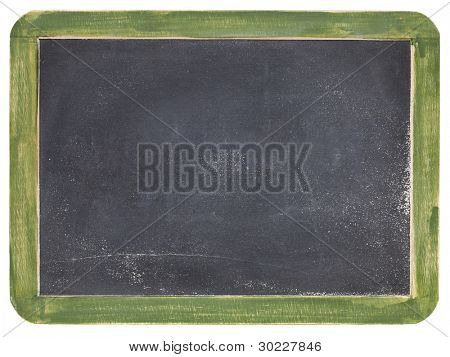 old blank slate blackboard with white chalk dust and texture, green wood frame