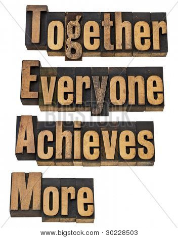 TEAM - together everyone achieves more - teamwork and cooperation concept - a collage of isolated words in vintage letterpress printing blocks