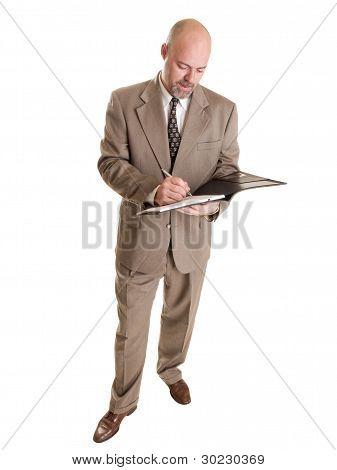 Empresario - tomando notas en Bloc de notas