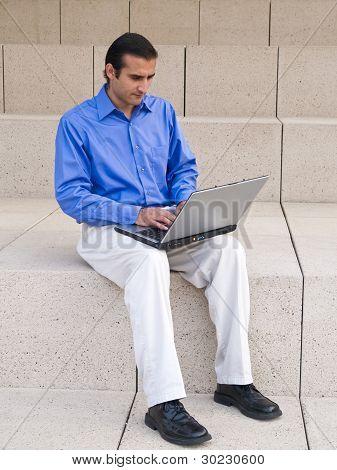 Hispanic Businessman With Laptop
