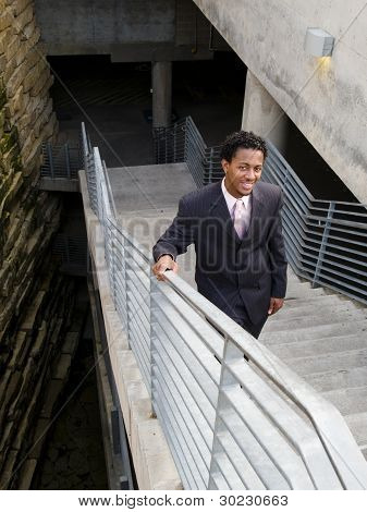 Smiling Businessman On Stairs
