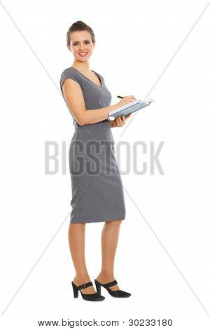 Female Employee Writing In Notebook