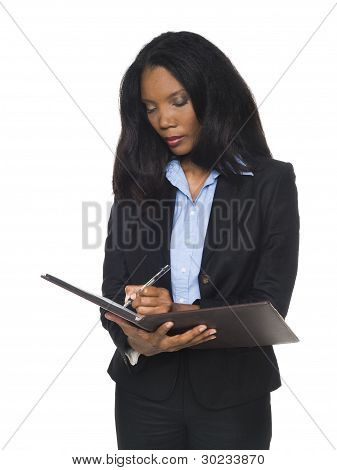 Businesswoman - Writing On Notepad