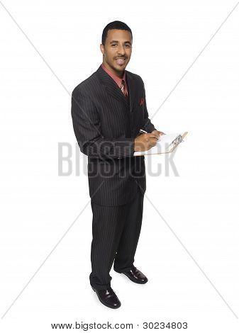 Businessman - Writing On Clipboard