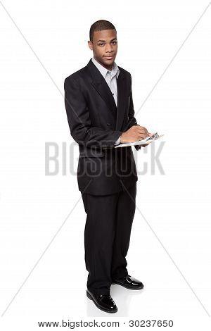 Writing On Clipboard - African American Businessman