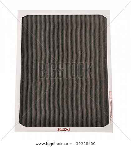 Dirty furnace filter on a white background. Great concept for changing your filter regularly