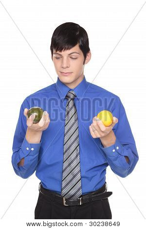Caucasian Man Comparing Lime To Lemon
