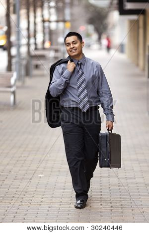 Hispanic Businessman - Walking Downtown With Briefcase