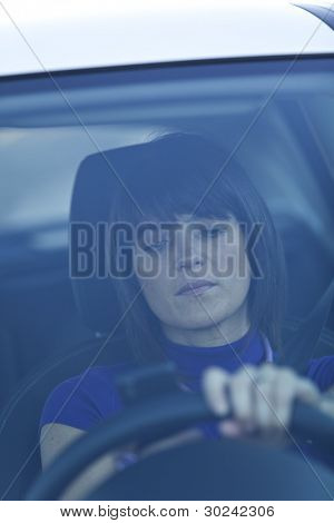 Woman in risk driving holding and talking at her cellphone