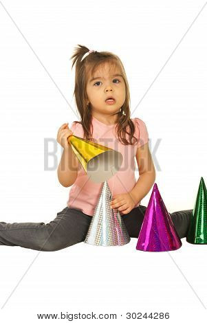 Toddler Girl Playing With Party Hats