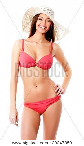 Beautiful woman in bikini and hat smiling on a white background