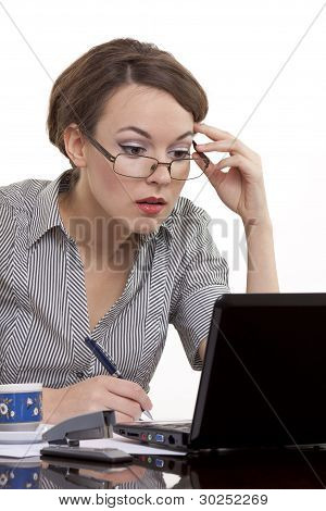 Young Business Woman Working On A Notebook