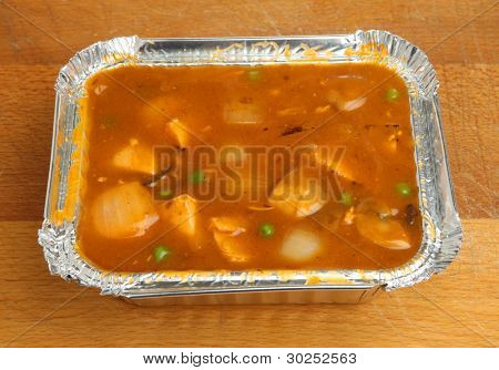 Chinese chicken curry takeaway in foil container