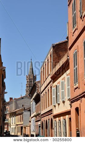 Toulouse In The South Of France With Typical Architecture Made Of Red Bricks Against Bright Blue Sky
