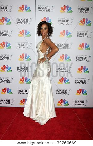LOS ANGELES - FEB 17:  Holly Robinson Peete arrives at the 43rd NAACP Image Awards at the Shrine Auditorium on February 17, 2012 in Los Angeles, CA.