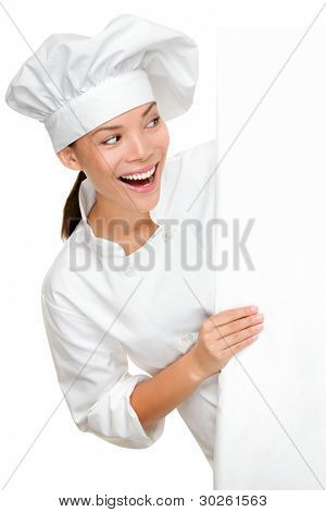 Baker, chef or cook showing sign billboard looking excited happy and smiling. Young female multiracial chef in chefs uniform isolated on white background.