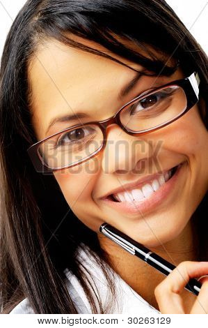 Smiling mixed race woman holding a pen with geeky glasses