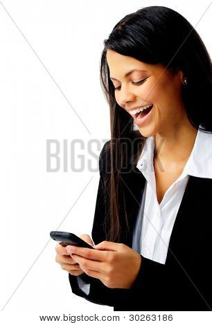 woman laughing with cell phone text message while wearing a suit isolated on white