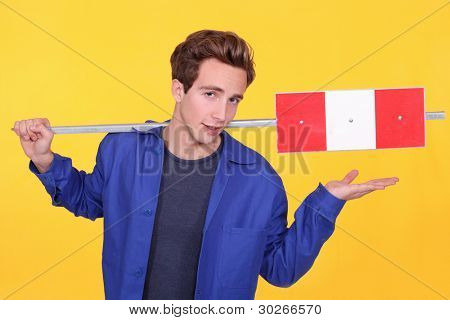 Building worker on yellow background