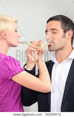 man and woman drinking champagne with love