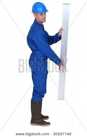 Man stood holding metal beam