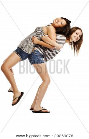 Playful Young Female Giving Piggyback Ride