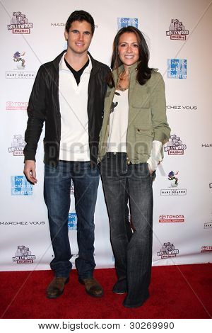 LOS ANGELES - FEB 19:  Robbie Amell; Italia Ricci arrives at the 2nd Annual Hollywood Rush at the Wilshire Ebell on February 19, 2012 in Los Angeles, CA.