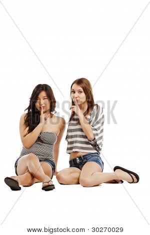 Young Girls Gesturing Silence On White Background