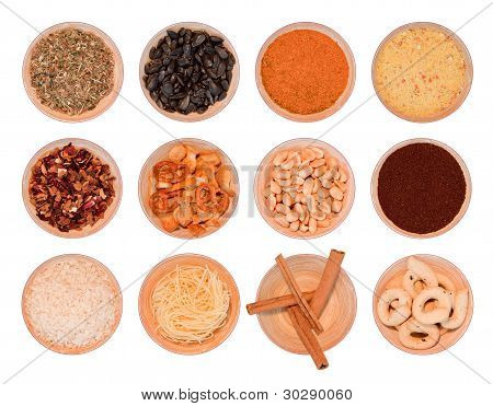 different wooden bowls with seasoning, tea, herbs, coffee, rice, cinnamon, noodles, brezels, peanuts
