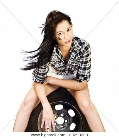 Sexy Woman Sitting On Car Tyre