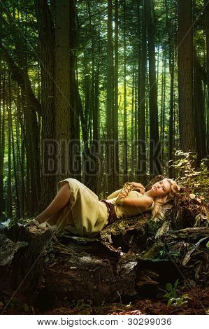 Blond girl in a magic forest