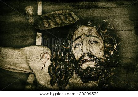 a background with a depiction of Jesus Christ in the holy cross