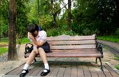picture of broken heart flower  - Thai student crying alone on the bench in the park - JPG