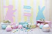 Easter! Colorful Easter Room Interior. Many Colorful Easter Eggs With Bunnies And Baskets Of Flowers poster