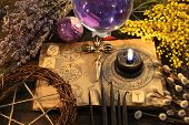 Pentagram, Runes, Black Candle And Magic Flowers With Open Book On Witch Table. Wicca, Esoteric, Div poster