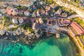 Malta, Il-mellieha. View Of The Famous Famous Village Popeye Aerial View And Bay On A Sunset Light poster