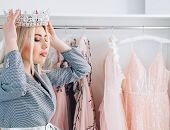 Luxury Fashion Boutique. Designer Prom Dresses. Elegant Evening Gowns. Young Lady Trying Tiara For H poster