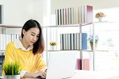Candid Of Happy Young Attractive Asian Woman Work At Home Office With Sme Business Owner, Young Entr poster
