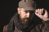 Handsome Man Wearing Demi-season Clothing. Bearded Male In Jacket, Gray Scarf And Cap On Head. Male  poster