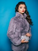 Perfect For Winter Cold. Young Woman Wear Elegant Winter Coat. Pretty Woman In Fashionable Fur Coat. poster