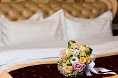 Brides Bouquet On The Bed. Wedding Night. Brides Bouquet On The Bed.flowers For Wedding. Bouquet For poster