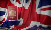 British passport on the flag of the UK United Kingdom. Getting a UK Great Britain passport,  natural poster