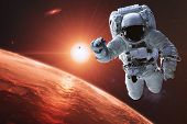 Astronaut In Outer Space Near Mars Planet Of Solar System Closeup. Science Fiction. Elements Of This poster